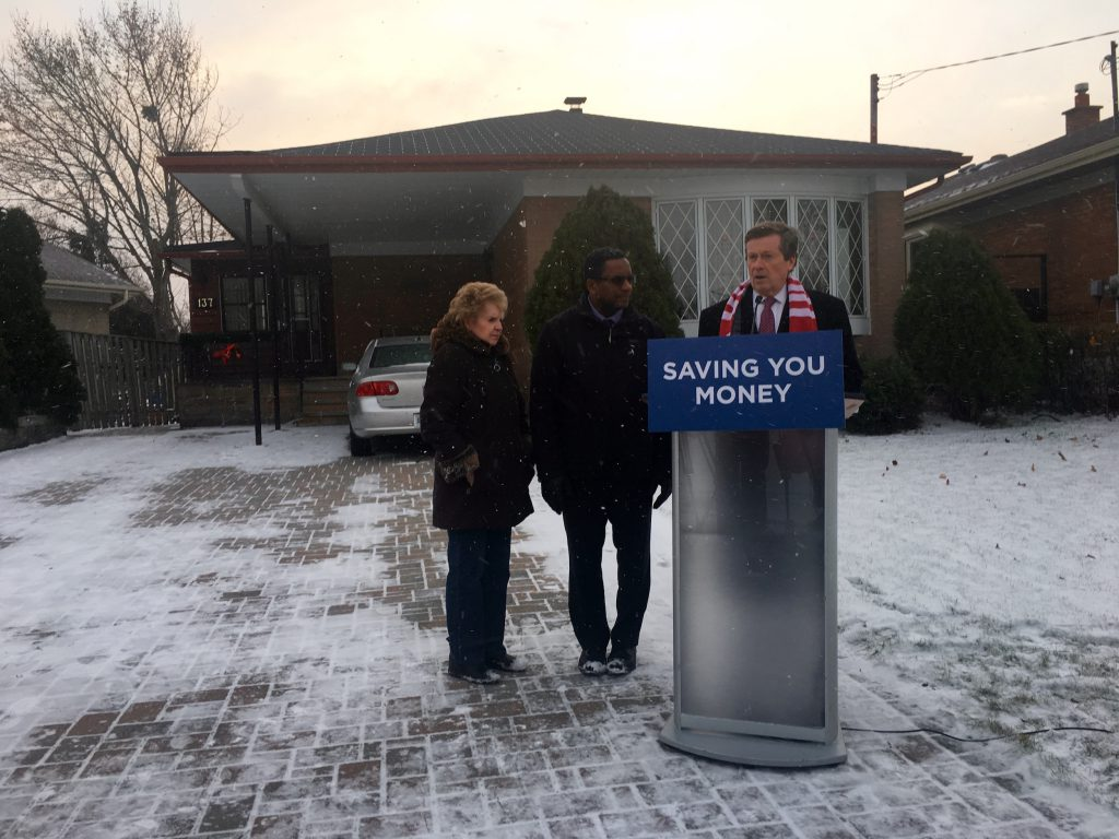 7:43 a.m., Nov. 21, 2016. Outside Marcia Stiles, left, home in Scarborough, Mayor John Tory makes an announcement about solid waste collection with Councillor Michael Thompson standing by.