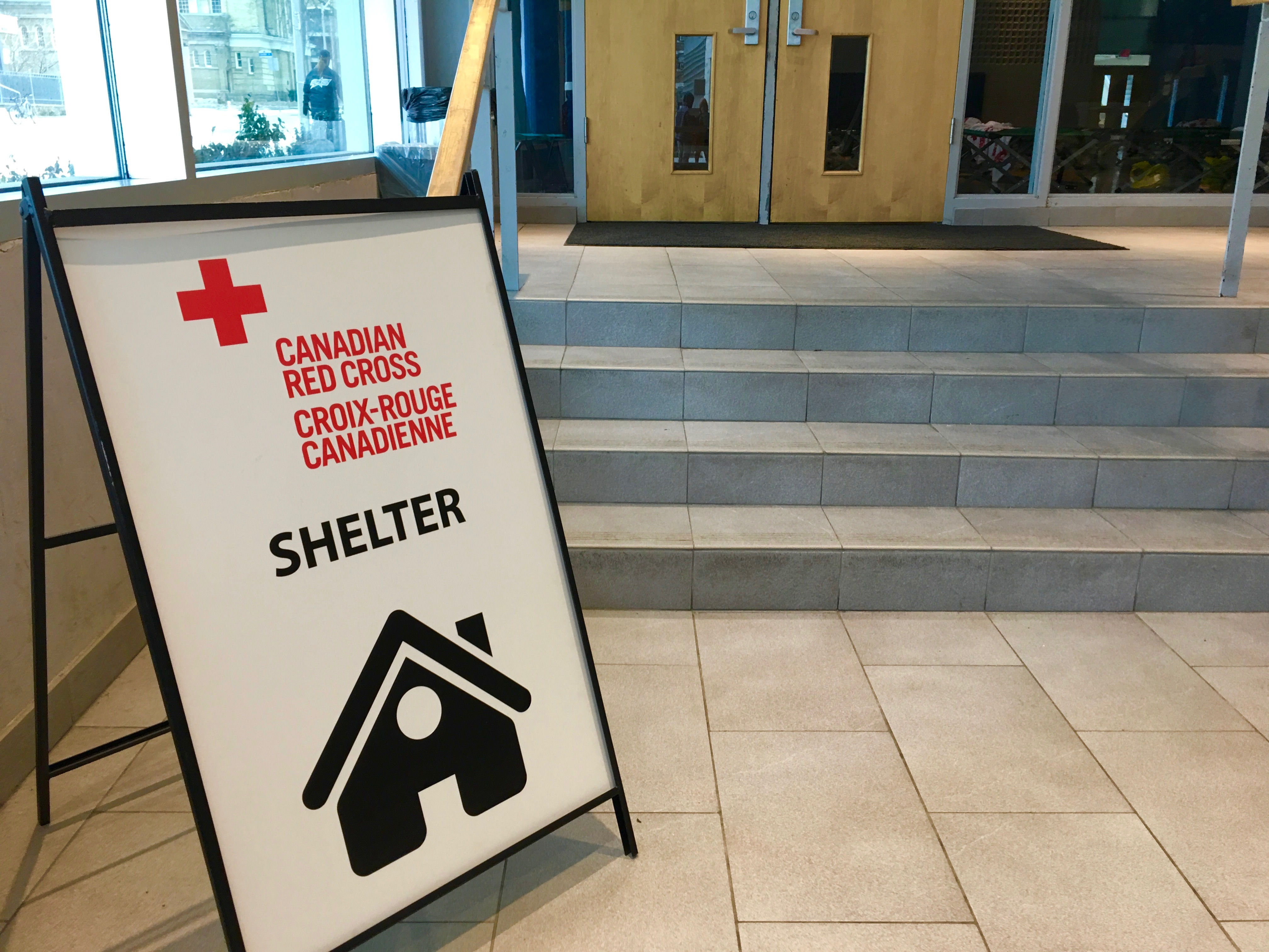 1:30 p.m. Feb. 10, 2017. A Canadian Red Cross sign set up at Wellesley Community Centre outside the gymnasium where residents of a Toronto Community Housing building were forced to sleep last night, following a fire.