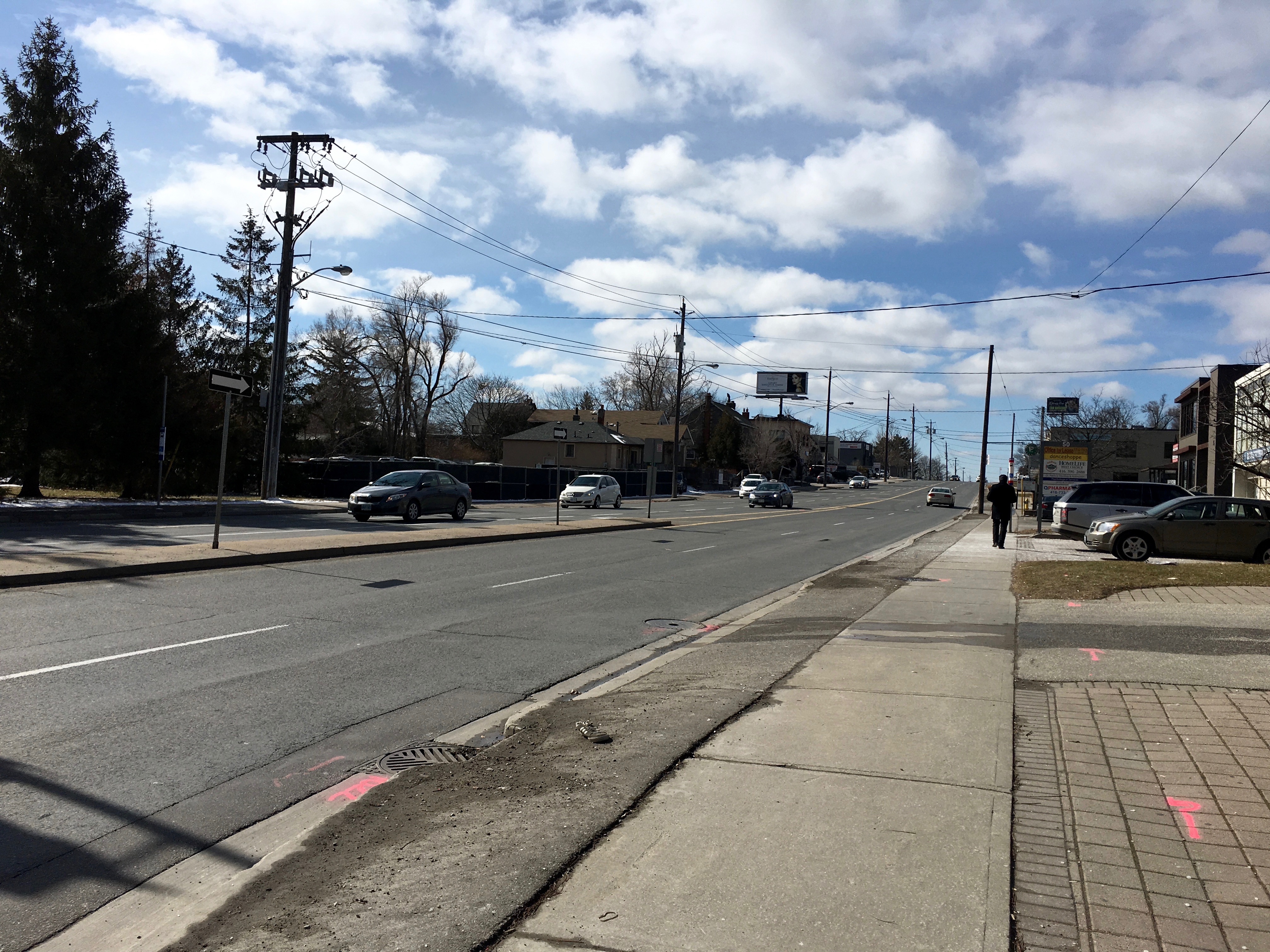 12:13 p.m., March 2, 2018. Beecroft Road has a median near Sheppard Avenue, and a sidewalk with an adjoining paved strip.