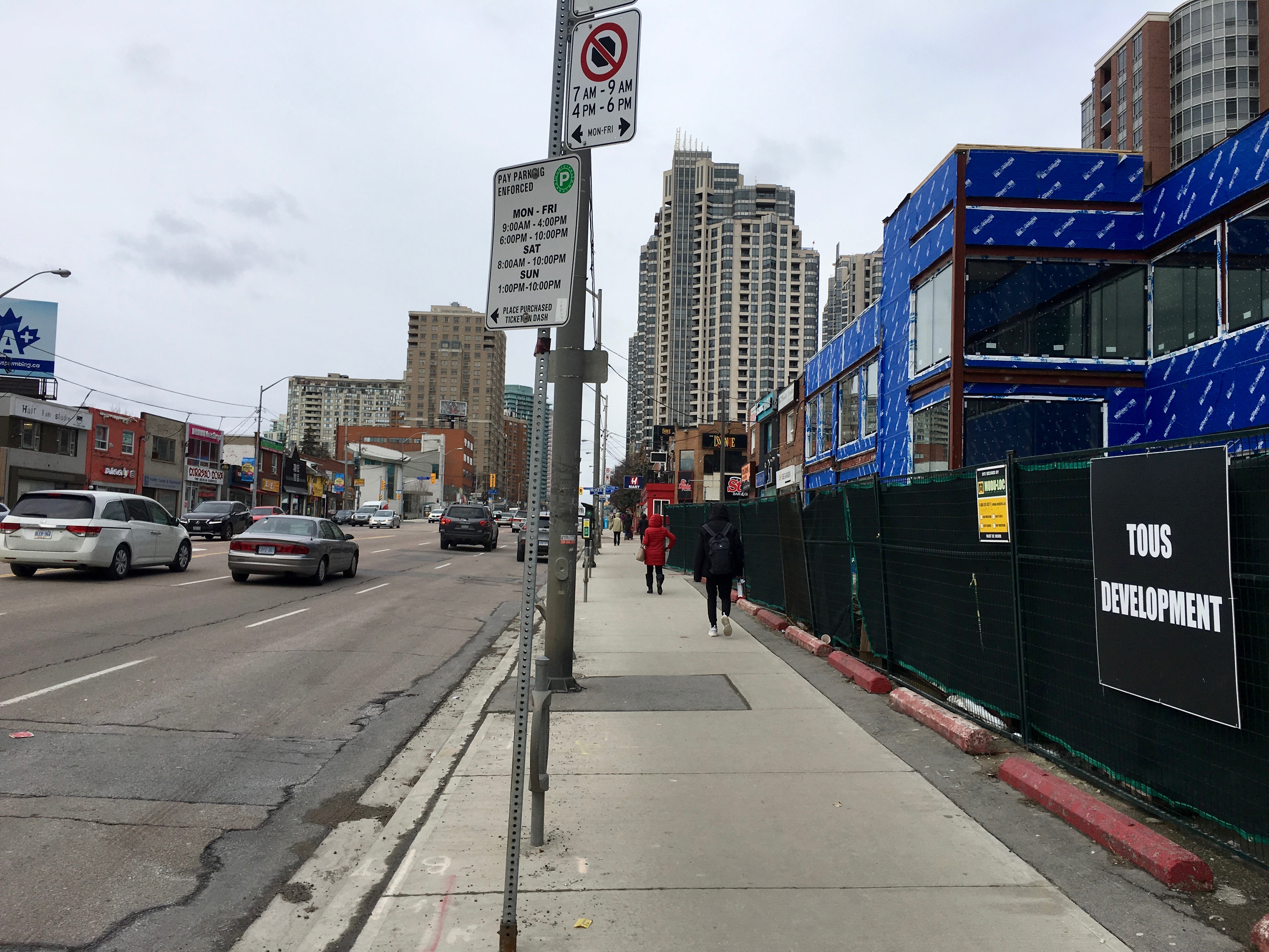 2:31 p.m., March 2, 2018. Development borders at the edge of this sidewalk on Yonge Street, comparatively narrow to other parts of the strip.