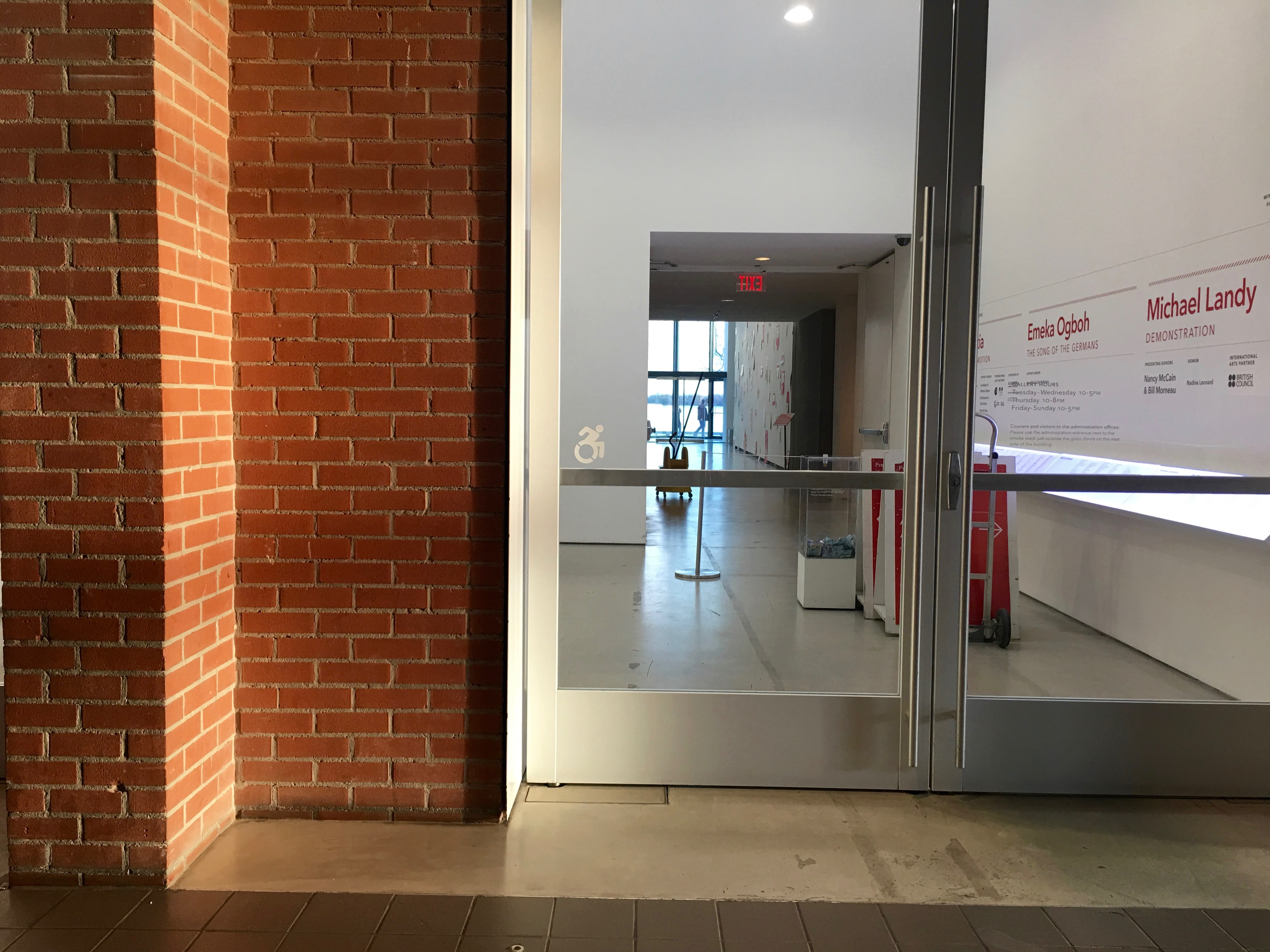 6:59 p.m., March 21, 2018. The Power Plant Contemporary Art Gallery has put the Dynamic Symbol of Access on their front door. This is an example of a place where the updated symbol can be used without contravening the Ontario Building Code.