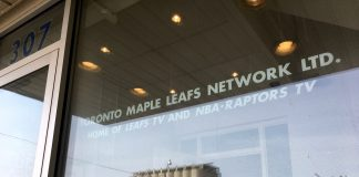 3:01 p.m., March 22, 2018. The reflection in the front window of 307 Lake Shore Blvd., the site of Sidewalk Toronto's new headquarters and engagement space, planned to open later this year. The sign on the front window is for Toronto Maple Leafs Network Ltd. (now MLSE).
