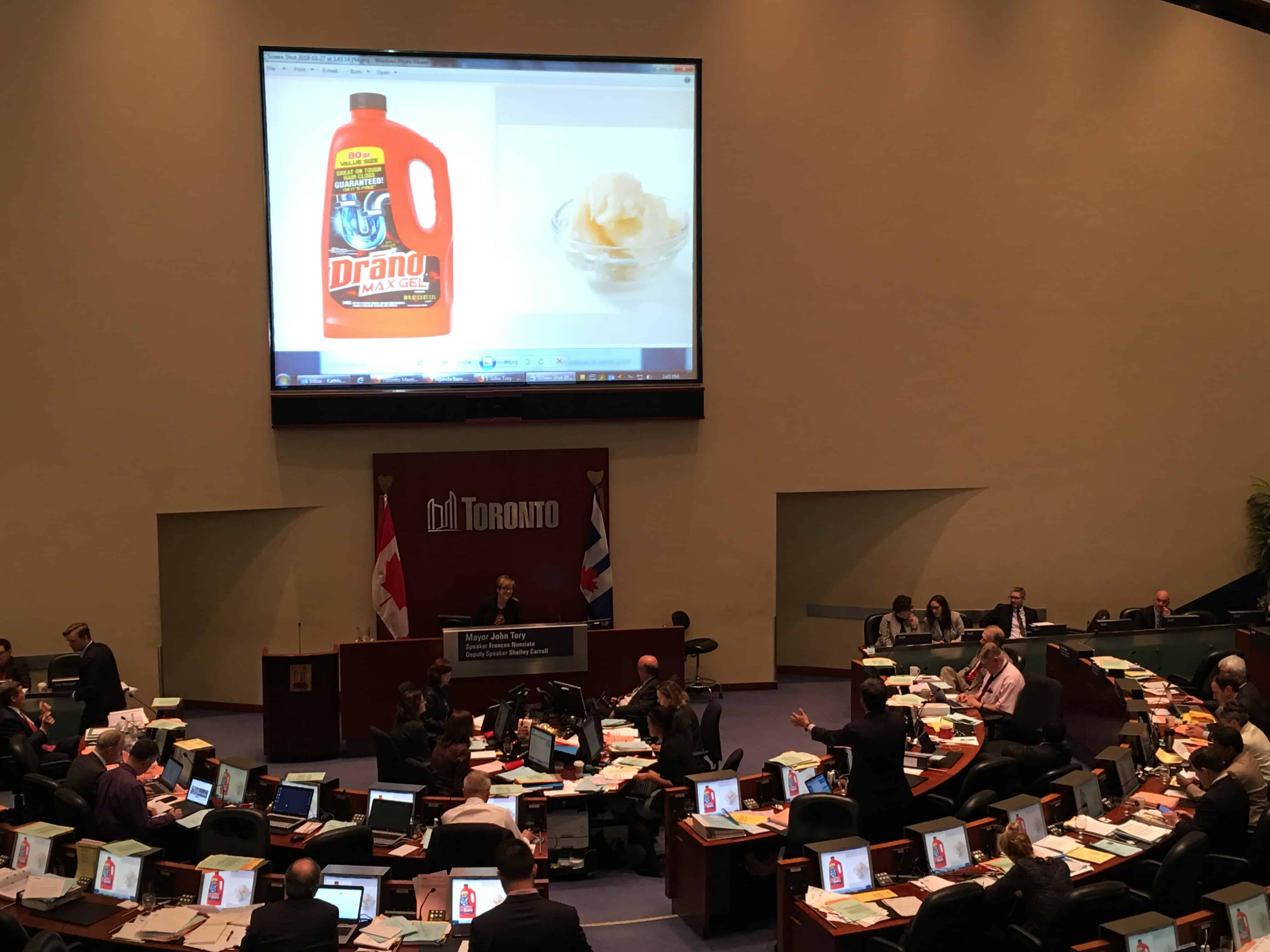 3:43 p.m., March 27, 2018. Deputy Mayor Denzil Minnan-Wong illustrates the decision council has to make for Yonge Street using images of Drano and lard.