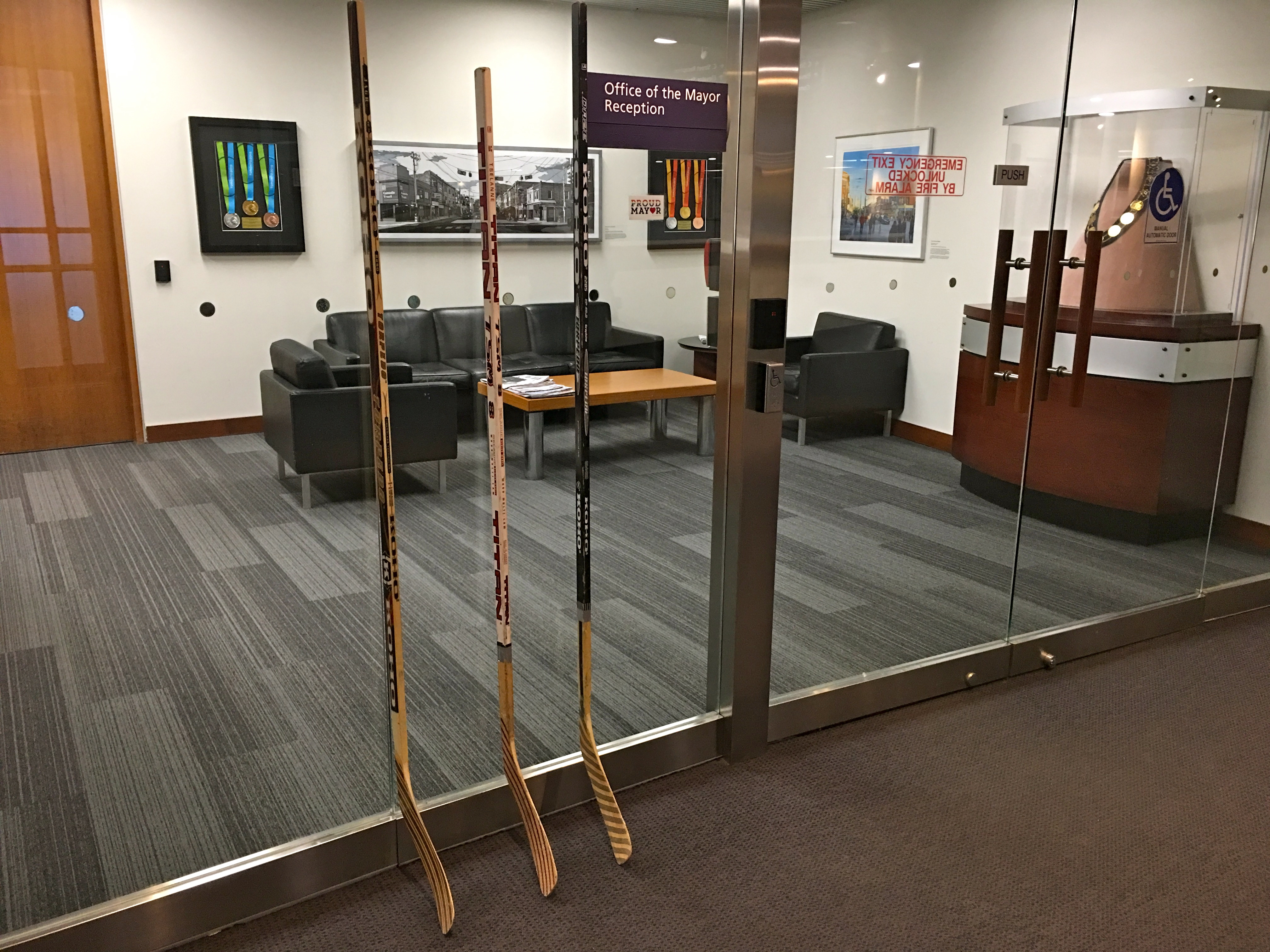 "11:29 a.m., April 10, 2018. Sticks outside Mayor John Tory's office. On Tuesday, Tory said to reporters, ""You know, it's shocking when these things actually happen in a given moment in time, but the time that becomes the most difficult is when the reality sets in, and when a few weeks have passed, and we just want those people in Humboldt and people around the country who are so profoundly affected by this to know that the people in the city of Toronto at the mayor's office are deeply affected by this as they are and that we're thinking about them."""