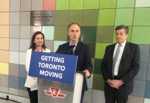 "10:22 a.m. May 10, 2018. TTC Chair Josh Colle at podium: ""I would say that any of the party leaders right now who are running to be premier should ride the Dufferin bus. Councillor Bailão will take them on the south end and I'll take them on the north end."" Councillor Ana Bailão (left) and Mayor John Tory (right)."