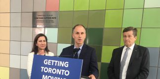 """10:22 a.m. May 10, 2018. TTC Chair Josh Colle at podium: """"I would say that any of the party leaders right now who are running to be premier should ride the Dufferin bus. Councillor Bailão will take them on the south end and I'll take them on the north end."""" Councillor Ana Bailão (left) and Mayor John Tory (right)."""