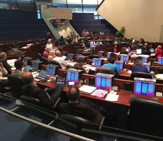 4:22 p.m. May 24, 2018. Chair of the Public Works and Infrastructure Committee, Councillor Jaye Robinson (standing), speaks to council while Mary-Margaret McMahon (left), looks on.