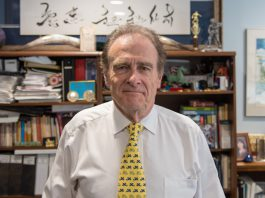 """Dec. 6, 2017. Councillor Norm Kelly stands in his office at Toronto City Hall. Kelly, a former history teacher, has proved popular among Toronto youth: """"My ability to connect, say, with millennials, stems from the fun that I had in the classroom with young people."""" (Photo credit: Luke Trohimchuk/Signal Toronto)"""