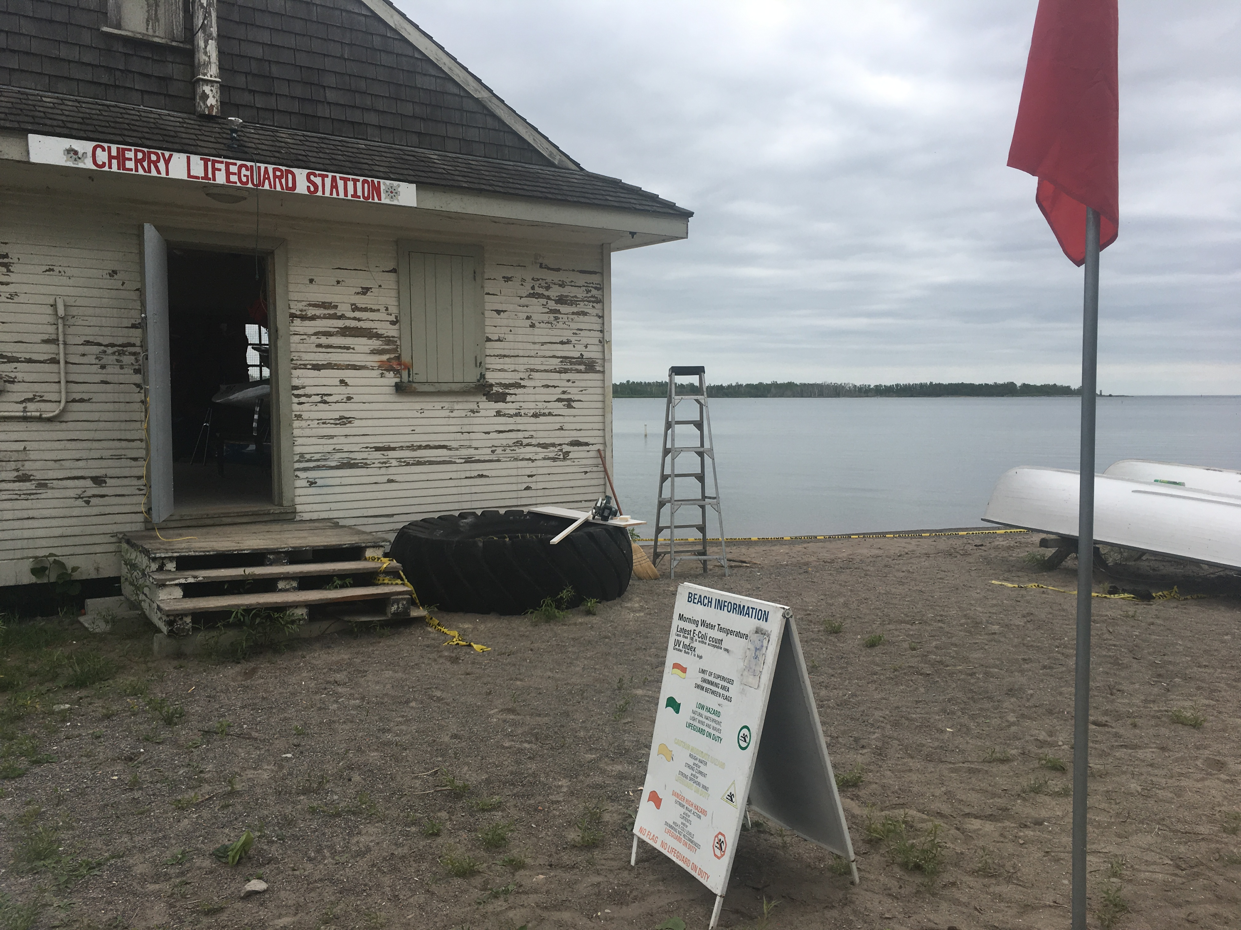 2:18 p.m. June 5, 2018. Lifeguards on duty post information including a flag indicating if the water is deemed safe to swim according to the E. coli quality.