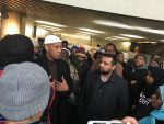 11:32 a.m., Feb. 1, 2017. Said Rageah, Imam/founder of Sakinah Community Center, speaks with protesters in the rotunda of City Hall about the importance of securing places of worship and schools for the next generation.