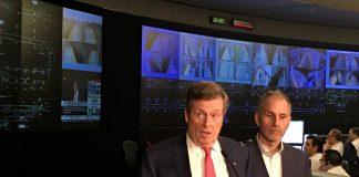 10:48 a.m., Feb. 13, 2018. Mayor John Tory speaks at the TTC control centre the morning after the budget is passed, in front of a television broadcasting him speaking at the same press conference. (Right: TTC Chair Josh Colle)