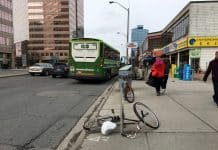 2:54 p.m., March 2, 2018. A bike lies across a wide section of sidewalk on Yonge Street on Friday. City council will vote later this month on whether bike lanes should be included in the road reconstruction plan for the stretch of Yonge from below Sheppard Avenue to above Finch Avenue.