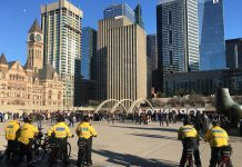 6:32 p.m., April 20, 2018. Police watch what is left of the crowd of pot smokers who gathered for the 420 pro-marijuana rally at Nathan Phillips Square.