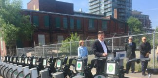 10:22 a.m., May 30, 2018. Mayor John Tory speaking at the announcement for Bike Share free half-hour rides on Wednesdays in June. Rhonda English, Chief Marketing Officer at CAA, looks on.