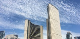 11:30 a.m. July 13, 2018. Toronto City Hall.