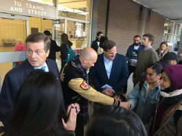 7:47 a.m. Mayor John Tory looks over his shoulder while meeting potential voters with local candidate for Beaches–East York, Brad Bradford, at a bus platform at Main Street TTC Station. Liberal MP for Eglinton--Lawrence, Marco Mendicino, stands on the other side of Bradford.