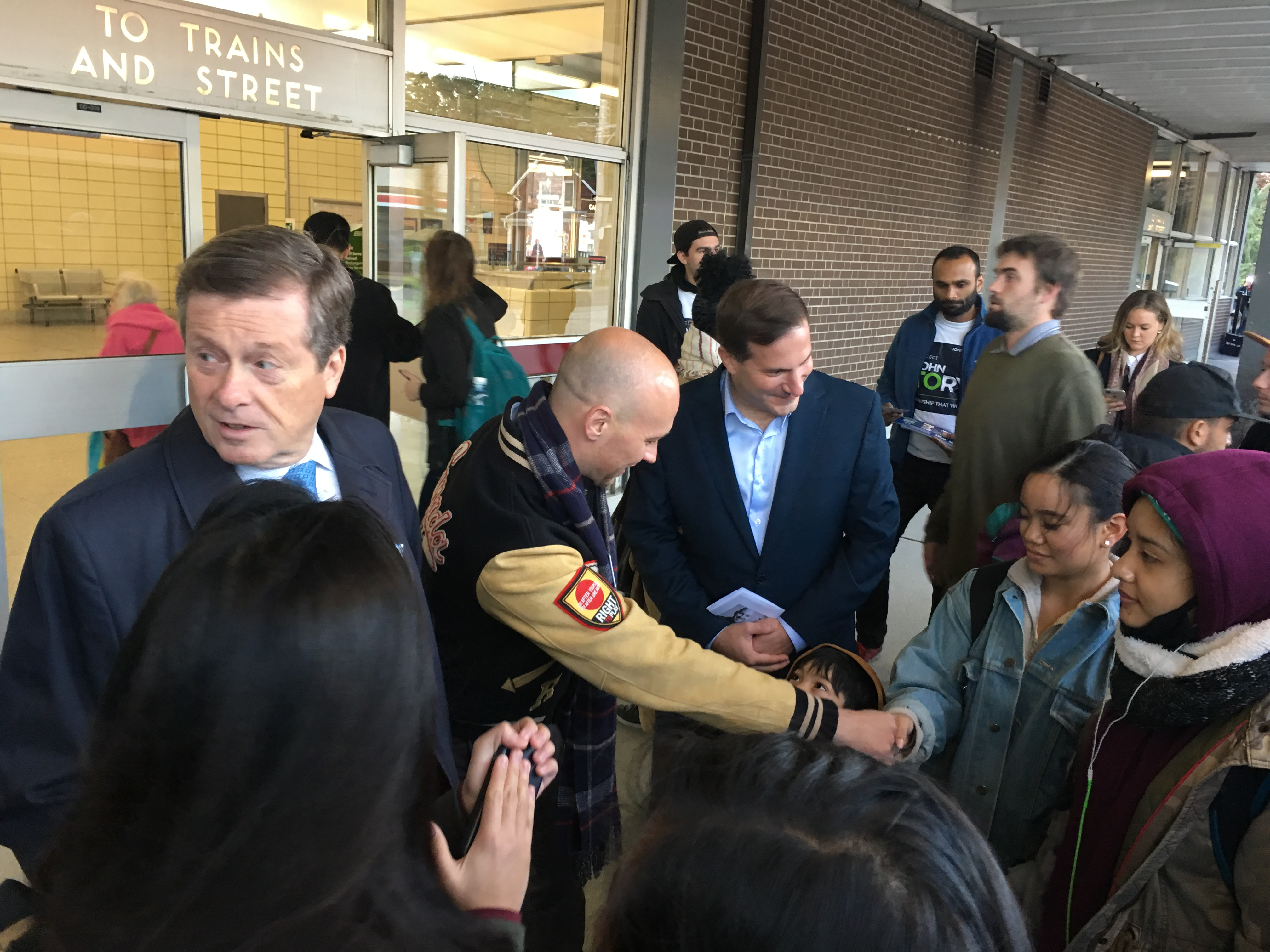 747 A M Mayor John Tory Looks Over His Shoulder While Meeting Potential Voters With