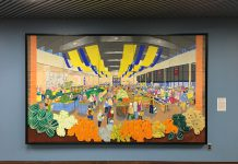 """2:09 p.m. Nov. 2, 2018. A piece from the City of Toronto Art Collection recently installed outside Committee Room 1 at Toronto City Hall. The piece is a representation of the North St. Lawrence Market, by Gerald (Jerry) Englar. The curatorial information on the right reads that Leida Englar donated the work last year, """"through a unique partnership of Jerry's friends and neighbours on the Toronto Islands as well as the landscape architecture community … This north market building was built in 1968 and demolished in 2016. The construction of a new market building is slated to begin in 2018."""""""