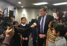 11:02 a.m. Nov. 20, 2018. Mayor John Tory, with Grade 4 and 5 students from St. Barnabas Catholic School and Kensington Community School, at Toronto City Hall, on National Child Day.