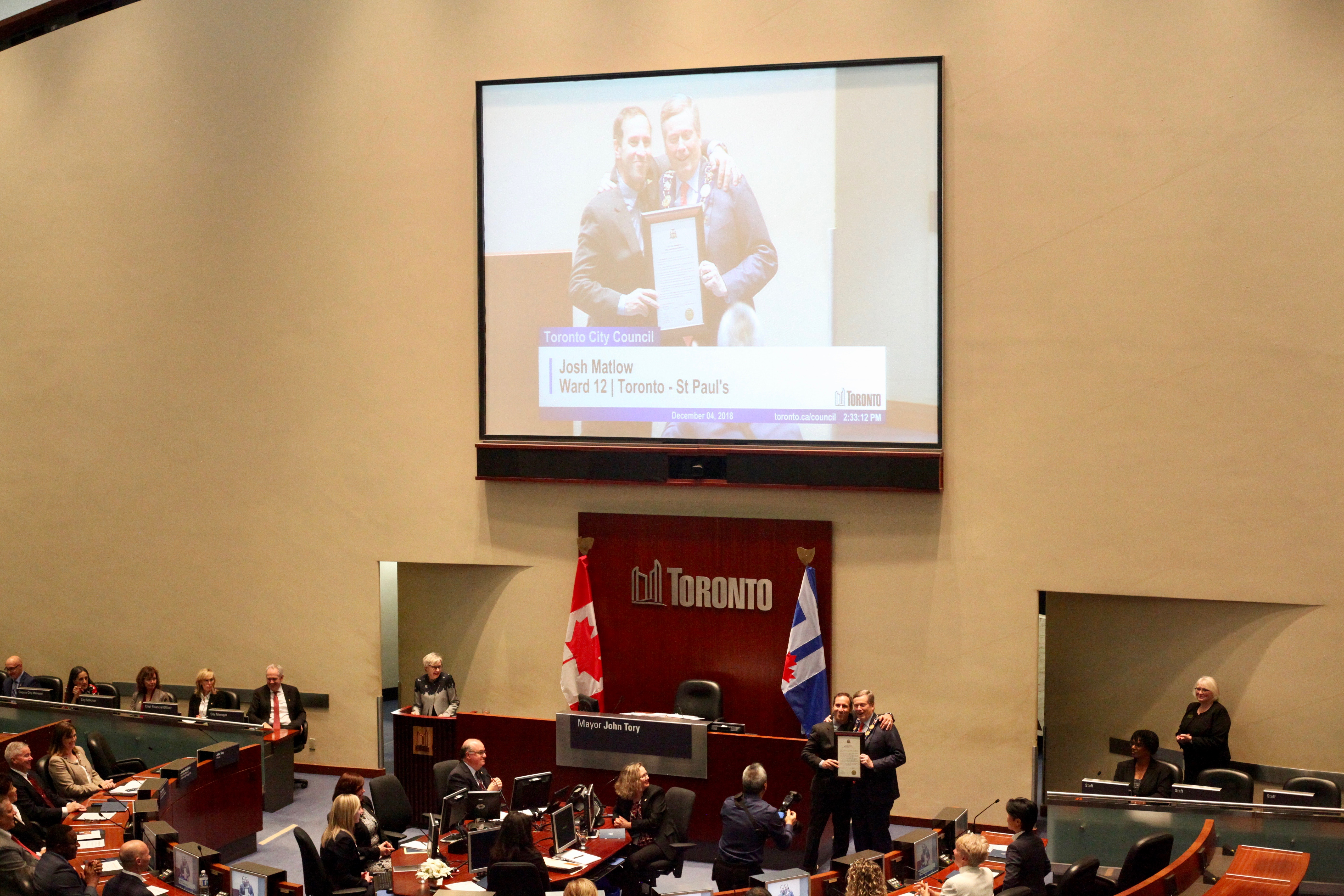 2:45 p.m. Dec. 4, 2018. Councillor Josh Matlow and Mayor John Tory enjoy a close moment as they pose for a photo at council's first meeting of the term.