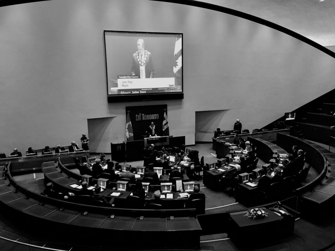 2:41 p.m. Dec 4, 2018. The first city council meeting of the 2018 - 2022 term. The number of members (and their chairs in chambers) were reduced from 45 to 26, following provincial legislation.