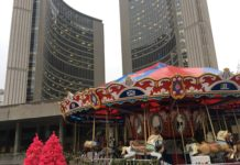 8:59 a.m. Dec. 14, 2018. A carousel is one of the amusements at the holiday fair at Nathan Phillips Square, running until Dec. 23.