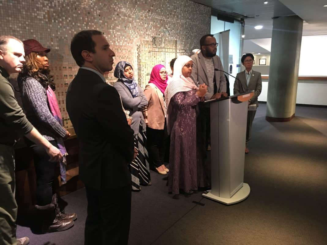 9:40 a.m. Regent Park community organizers Ismail Afrah and Sureya Ibrahim speak to reporters at city hall about the importance of funding and access to programs in Regent Park. City councillors Josh Matlow and Kristyn Wong-Tam stand to either sides of the podium.